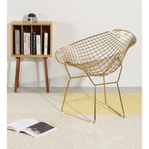 ażurowe złote krzesło metalowe